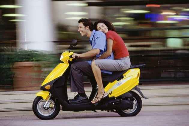 Couple on Motor Scooter - Credit- Purestock - 79082112