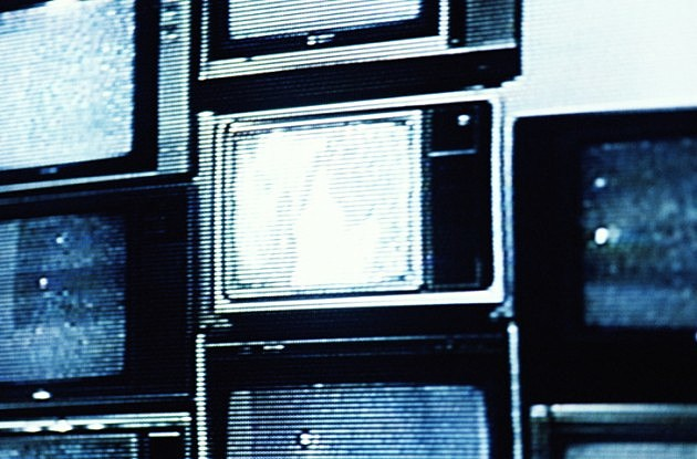 Stack of Televisions Showing Static