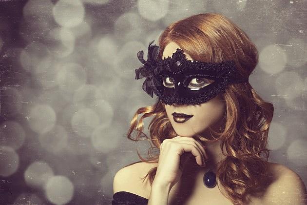 Beautiful women in carnival mask - Credit- iStock