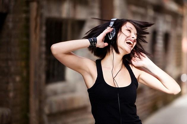 girl-dancing-with-headphones-on-music