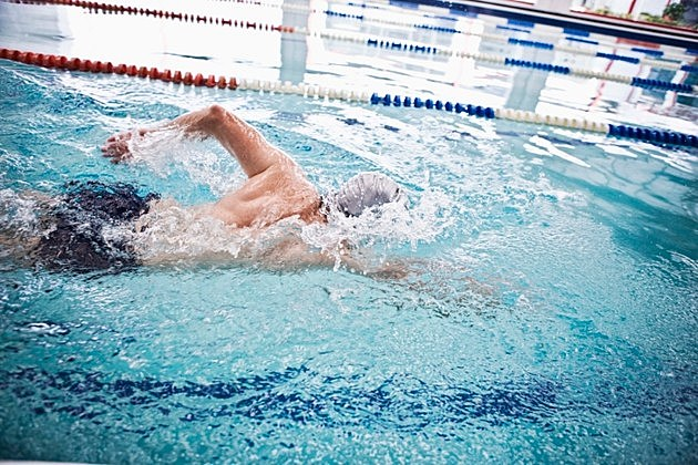 Man swimming in an indoor swimming pool